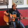 Trans March Benefit unPLUGGED concert : On Friday May 6, 2011, at the invitation of my friend Tony De Renzo, I attended a benefit concert for the upcoming Trans March. This concert of poetry, singing and acoustic guitar was phenomenal. This benefit was for a trans rally and march scheduled for June 24th, 2011 that will depart from the corner of Dolores Street and 18th Street about 7pm.  This event was a genuine treat. There was a lot of talent on stage including: ✰ Tonilyn A. Sideco  ✰ Luis Gutierrez  ✰ Shawna Virago  ✰ Storm Miguel Florez  The aim of the San Francisco Trans March is to inspire all trans and gender non-conforming people to help create a world and a life where we are all safe, appreciated, loved and empowered. The purpose is to create a space for diverse communities to unite and achieve the social justice and equality that everyone deserves.  While we have made progress in the last several decades, there is still much road ahead. Events like this help to raise awareness and spread the message that life will be better for everyone with acceptance, tolerance and yes, even celebration of the differences among us.  A world where the richness of these differences is appreciated and honored rather than used to divide is the one I seek.  For more about the organization behind the Trans March, see: http://www.transmarch.org/  To listen to musical selections, see Tony De Renzo's video: http://www.youtube.com/watch?v=r6ZJbwCUZHw  To see the actual Trans March on June 24th, 2011 that this event helped finance, go to:  http://david-elliott-lewis.smugmug.com/Street-Scenes/Trans-Rights-are-Human-Rights/17792766_C7jvtW  ________________________EVENT FACTS: WHEN: Friday, May 6th, 2011 7pm to 9:30pm WHERE: Dolores Park Cafe, 501 Dolores Street, San Francisco WHAT: Fundraising for the Trans March on June 24th, 2011 WHY: Celebrating and asserting the rights of Trans and gender non-conforming persons. PHOTOS: Sequenced in order taken with my Canon EOS Rebel T2i using a 18-55mm Image Stabilized USM lens. Photos are unretouched other than cropping and brightening.  ________▂ ▃ ▅ ▆ █ For best viewing results, MAXIMIZE your browser window to full screen █ ▆ ▅ ▃ ▂________